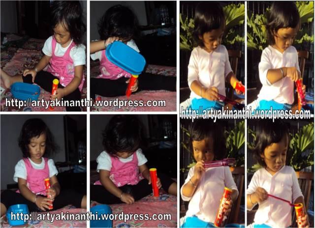 Kinan bermain dengan permen