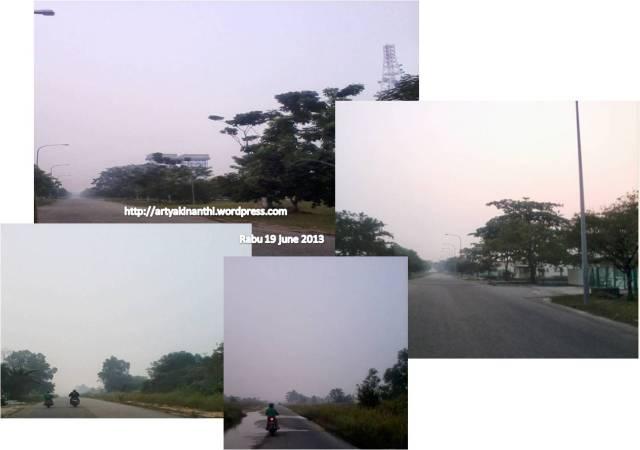 Kabut asap terlihat dari perjalanan pulang sore 19 juni 2013