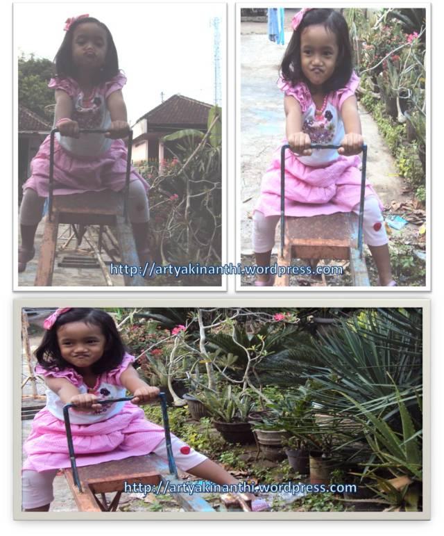 Kinan bermain jungkat jungkit di kebun Uti